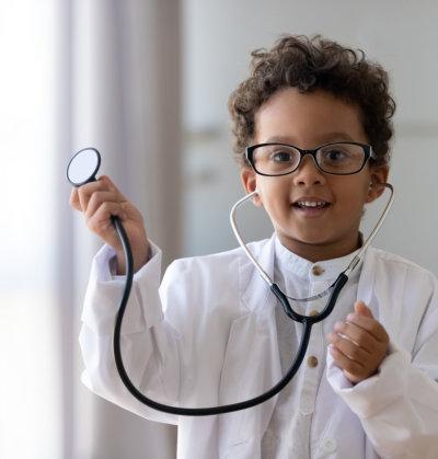 kid holding stethoscope